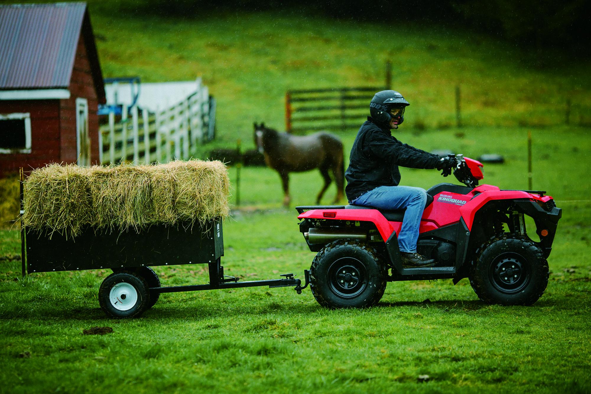 KingQuad ATV Pulling wagon of hay